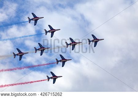 Paris, France - July 14 2021: The French Air Patrol (french: Patrouille De France) Performing A Demo