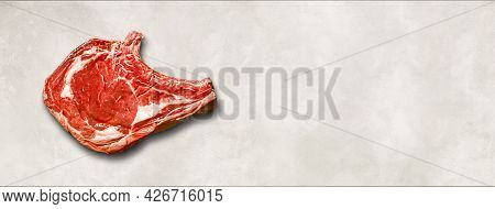 Raw Beef Prime Rib Isolated On White Concrete Background. Top View. Horizontal Banner