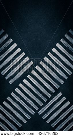 Crossing Lanes Of Two Pedestrian Crossings At The Crossroads In The City - Aerial Top View Shot. An