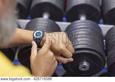 Hands Of A Man With A Smart Watch In The Gym Close-up.