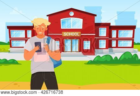 Schoolboy With Smartphone Is Communicating. Boy Is Using Mobile Device Near School. Male Character I