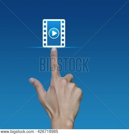 Hand Pressing Play Button With Movie Flat Icon Over Light Blue Gradient Background, Business Cinema
