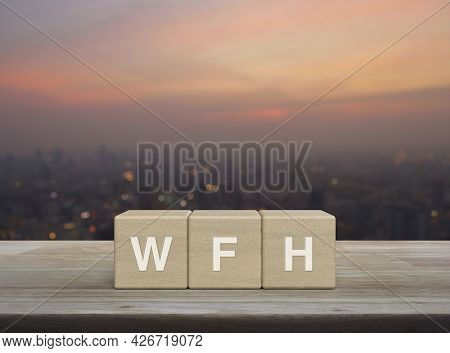 Wfh Letter On Block Cubes On Wooden Table Over Blur Of Cityscape On Warm Light Sundown, Business Wor