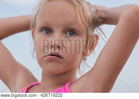 Children's Portrait, Child, Preschooler, Girl, Blonde, 6 Years Old, With Raised Arms, Pensive Eyes,
