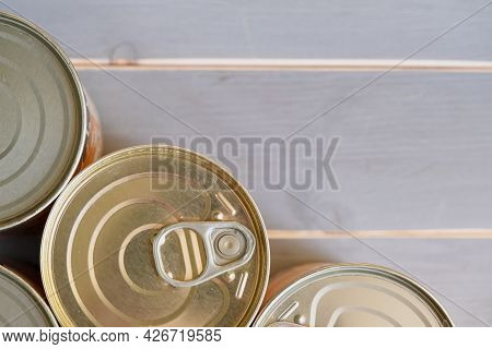 Tin Cans Of Food. Several Aluminum Cans With Long-term Storage. View From Above.