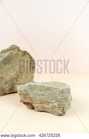 Stone Podium For Product Displays On A Pastel Background. Ideal Mock Up For Advertising. Vertical Ph