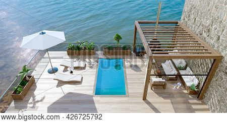 3d Illustration Of Luxury Contemporary Outdoor Wooden Patio With Swimming Pool Next To Lake. Top Vie