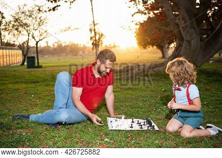 Happy Family. Parenthood And Childhood. Spending Time Together. Strategic And Tactic