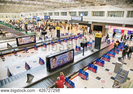 Alanya , Turkey- October 20, 2020:  International terminal in Antalya Airport. Information display about airport zones in a large, bright, modern hallin . Antalya, Turkey.