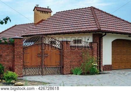 Luxury Country Cottage With A Beautiful Brick Fence And Wrought Iron Gates. Real Estate, Architectur