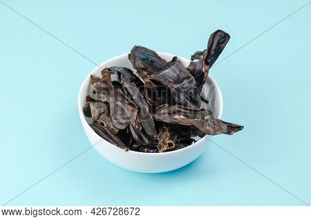 Training Treats For Pets On Blue Background. Natural Air Dried Dog Treats In A White Ceramic Bowl. Y