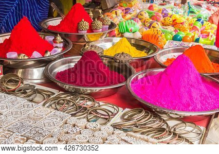 Stamps, Bracelets And Color Powder At A Market Stall In Orchha, India