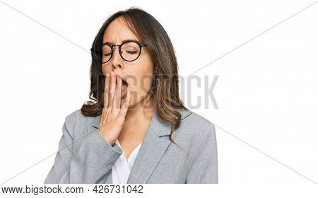 Young brunette woman wearing business clothes bored yawning tired covering mouth with hand. restless and sleepiness.