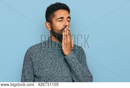 Young african american man wearing casual clothes bored yawning tired covering mouth with hand. restless and sleepiness.