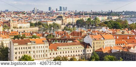 Panoramic View Over The River Moldau (vltava) And Historic Buildings In Prague, Czech Republic