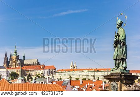 Statue On The Charles Bridge Overlooking The Castle In Prague, Czech Republic