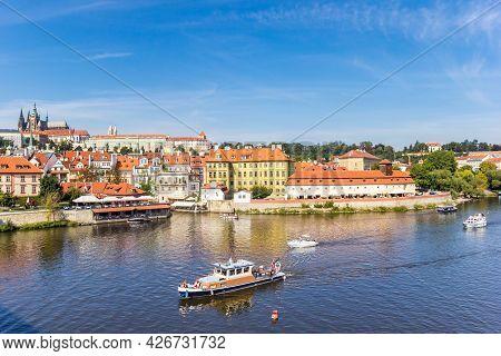 Boats On The River Moldau (vltava) In Historic City Prague, Czech Republic
