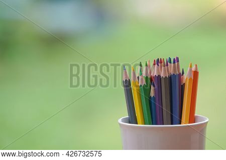 Colorful Colored Pencils On The Blurred, Broken Background. Back To School Set Multicolored Pencils