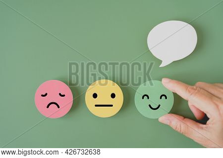 Human's Hand Holding Happy Smile Face Paper Cut With Speech Bubble On , Satisfaction Survey ,good Fe