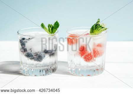 Glasses Of Strawberry And Blueberry Summer Water. Cold Fruit Drinks. Summer Refreshing Healthy Drink
