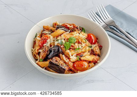 Pasta Alla Norma, Sicilian Pasta Dish With Eggplant Garnished With Basil Leaves