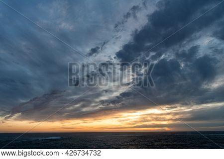Early Morning Sunrise Over Sea. Ocean Sunset On Sea Water With Sunset Sky. Seascape Sundown.