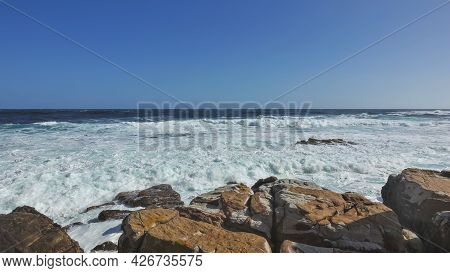 Cape Of Good Hope In Cape Town. The Waves Of The Turquoise Atlantic Ocean Break On The Coastal Bould