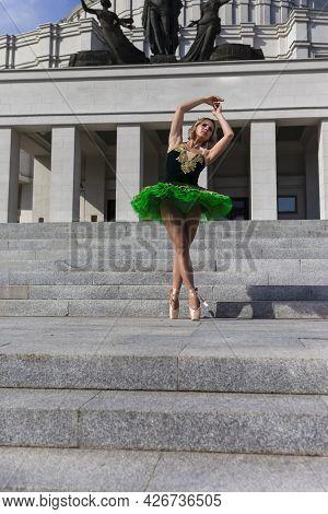 Ballet And Dance Concepts. Professional Caucasian Ballet Dancer In Green Tutu Dress Posing In Dance