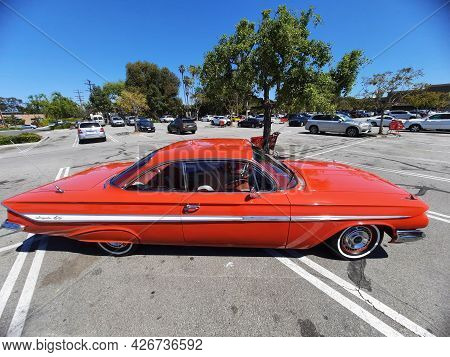 Los Angeles, California Usa - March 28, 2021: Red Chevrolet Impala Retro Car Up Side View