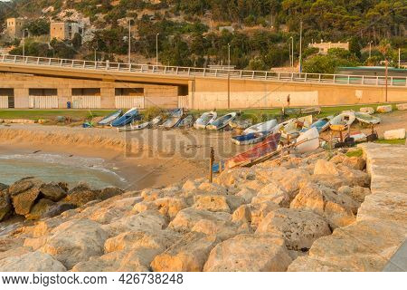 Small Boats On The Beach At Sunrise. Haifa, Northern Israel