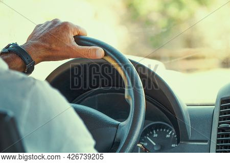 Concept Of Taxi Driver Steering Wheel And Driving Passenger Taxi. Hands Of Driver In A Modern Bus By