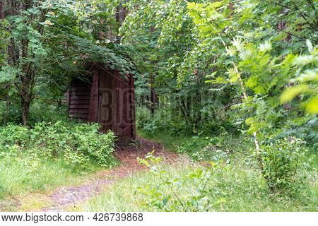 A Wooden Building Of A Toilet Or Toilet In A Remote Forest In A National Park In Russia On The Curon