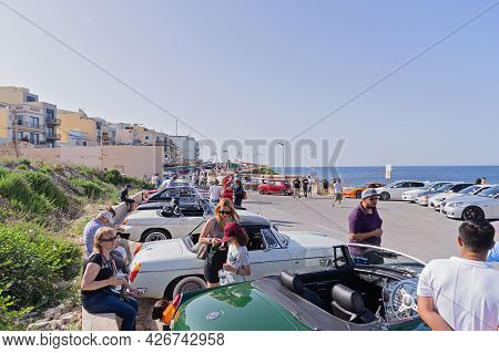Traditional Vintage Car Show Outdoor And Crowd In Xghajra, Malta: Xghajra, Malta - June 7, 2019