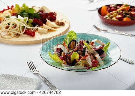 Mussels Vongole With Salad, Mussels Cooked In White Wine Sauce, Mussel Appetizer On The Table Surrou