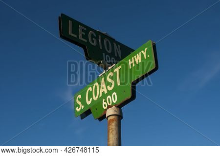 The Green Road Sign For South Coast Highway In Southern California, Photographed At Sunset With A Cl