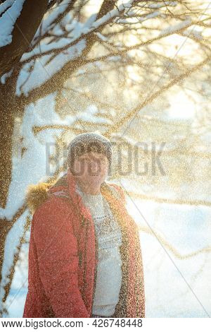 Portrait Of A Man On A Snowy Day In The Forest. The Guy In Winter Sportswear.