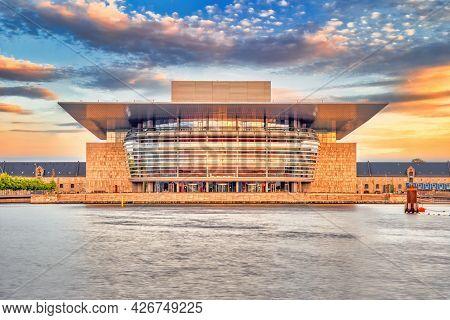 Copenhagen, Denmark - July 02, 2021: The Copenhagen Opera House In The Evening With Sunset Warm Ligh