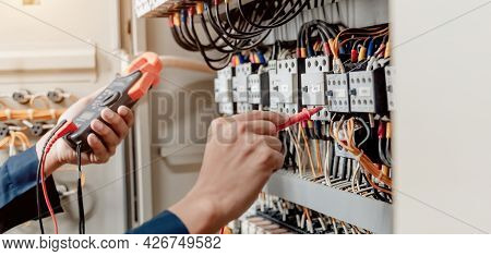 Electrician Engineer Uses A Multimeter To Test The Electrical Installation And Power Line Current In