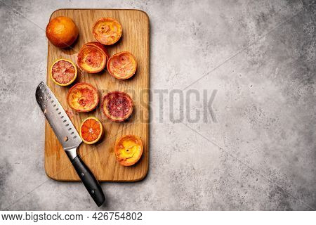 Sliced Sicilian Blood Oranges And Freshly Squeezed Juice With Manual Juicer Squeezing