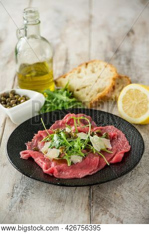 beef carpaccio with arugula capers and parmesan cheese