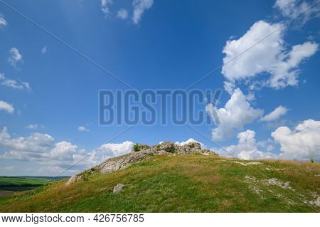 View to limestone toltres, rock residues of ancient coral reefs of dried Sarmatian sea at the North of Moldova