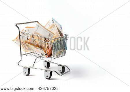 Euro Banknotes In A Trolley On A White Background. Concept. High Quality Photo