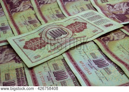 Money Background From Old Banknotes Of The Yugoslav Dinar In Denomination Of 100 Dinar Series 1965-1
