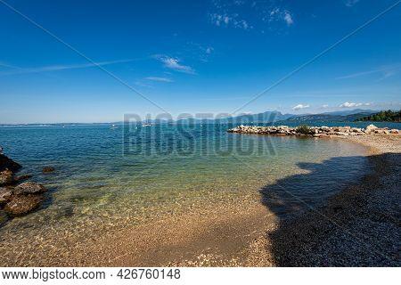 Beautiful Beach On Lake Garda (lago Di Garda) In Front Of The Small Village Of Lazise. Verona Provin