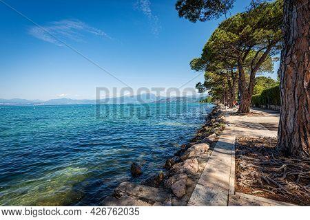 Coast Of Lake Garda (lago Di Garda) In Front Of The Small Lazise Village, Tourist Resort In Verona P