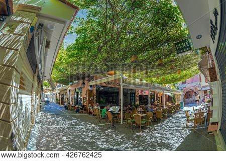 Rethymno, Crete Island, Greece - June 20, 2021: View With Small And Picturesque Street Terraces With