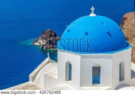 Typical White And Blue Architecture With Domes And Churches Of Oia Village On Santorini Island, Gree