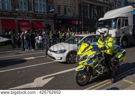 London - May 29, 2021: British Police Motorcyclist At A Freedom For Palestine Protest Rally In Londo