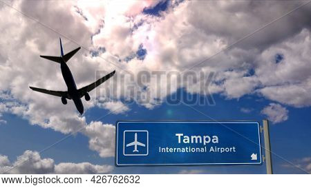 Plane Landing In Tampa Florida, Usa Airport With Signboard