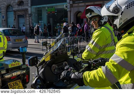 London - May 29, 2021: Smiling British Police Motorcyclist At A Freedom For Palestine Protest Rally